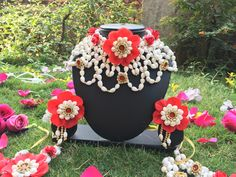This amazing artificial flower jewellery which looks exactly like fresh flowers is a must have if you are unable to opt for fresh flower jewellery .To get one for yourself or for your friends and relatives for their wedding kindly contact 8779268166 . Flower Jewellery For Mehndi, Flower Jewelry, Wedding Jewelry, Real Flowers, Artificial Flowers, Pretty Flowers, Flower Ornaments, Bridal Accessories, Flower Decorations