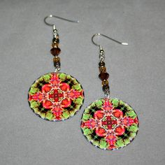 Silver dangle earrings with an autumn leaf mandala sacred geometry charm titled Fall Dream Catcher. <br /> <br />These lightweight, dainty silver earrings begin with a dangle of chocolate and topaz Czech glass beads and amber Swarovski crystals that accentuate the colors in the mandala charm that has scalloped edges that catch the light. The mandala charm is 1 %E...
