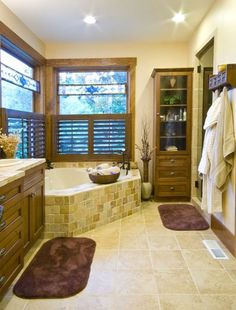 Shutter blinds add privacy while keeping natural light in this master bath. The Tuscany #877