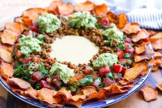 These paleo nachos are made with sweet potato chips and dairy free cheese sauce making them a great and healthy alternative to regular nachos.