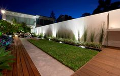 Rolling Stone Landscapes have created a lush and relaxing outdoor area to accompany a modern home.