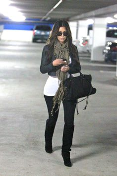 Kim Kardashian tan scarf black pants black bag