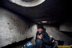 Mongolian homeless in Ulan Bator (Ulaanbaatar) living underground in a sewer that has hot water pipes running through it, to escape the bitter cold.