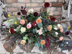 Old Mill Wedding, old stonework. Locally sourced wedding. Locally grown flowers. Burgundy, peach, coral, yellows, creams, dahlias, ranunculus,, amaranths, roses. Wisconsin wedding.