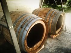 DIY dog houses from wine barrels. CUTE!! Now where can I find some barrels?!