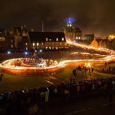 Guizers beginning to circle the galley with burning torches this evening at Up Helly Aa, with crowds of spectators lining the street, and the Town Hall in the background flying the raven banner. (Photo: David Gifford) #inspiredbyshetland #uphellyaa #firefestival #lerwick #Shetland