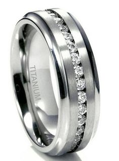 7mm titanium ring with a CZ channel and matte center with polished edges. SALE $84.99