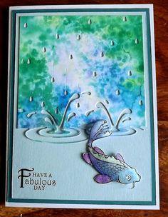 memory box splashes in puddles die, DesignsbyRyn fish stamp. Brusho & rock salt background.