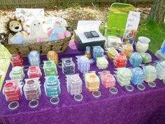 scentsy table display. samples on top of actual bar stock.    I will def be using this idea...