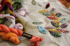 Interesting fabric, variegated and various threads, irregular placement of leaves