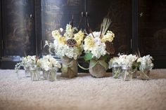 Rustic centerpiece groupings featuring fresh and dried florals in mason jars.  Flowers by Eden's Echo