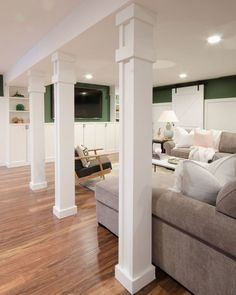 How to Turn Support Poles into Columns - The Chronicles of Home basement remodel bar Unfinished Basement Bedroom, Industrial Basement, Basement Bedrooms, Modern Basement, Basement Apartment, Basement Remodel Diy, Basement Renovations, Home Renovation, Home Remodeling