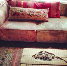leather couch // patterned pillows // stone-filled coffee table Except I dislike the table Decor, Home Decor Inspiration, House Design, Mid Century House, Bohemian Interior, Interior, Home Furnishings, Interior Inspiration, House Styles