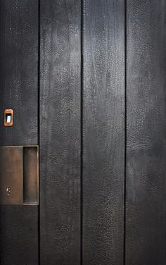 DETAIL - Beautiful charred wood door from Lakes Garage Door