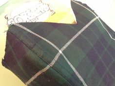 Front view of tartan, kilt wool quality corset waiting for fitting. By Corsets by Nasty Ginny .