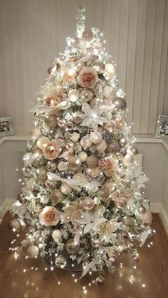 And Elegant Floral Christmas Tree Ideas Farmhouse Trees. Marvelous rose gold and bush pink decoration on Christmas tree with lights. Marvelous rose gold and bush pink decoration on Christmas tree with lights. Rose Gold Christmas Tree, Beautiful Christmas Trees, Christmas Tree Themes, Noel Christmas, Xmas Decorations, Rose Gold Christmas Decorations, Christmas Tree With Feathers, Christmas Bedroom, Christmas Ideas