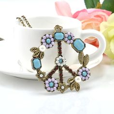 Peace Sign Hippie Fashion Necklace Antique Bronze Blue Gems White Flowers Faux Pearls by CaliSistersCreate on Etsy