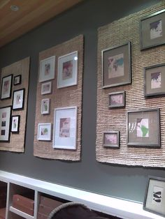 hang pictures over jute rugs nailed to wall