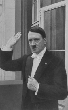 The most unlikely man in tails. Adolf Hitler saluting from the balcony on the day he became chancellor of Germany, 30 January 1933. The rest is history, as they say.