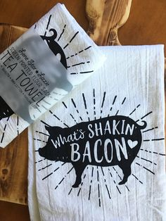 A fun tea towel for anyone who loves pigs... or bacon! This design looks great in black or pink ink.  Screen printed by hand on a soft flour sack 100% cotton tea towel with a hanging loop. Makes a great gift!  Because every tea towel I make is unique and hand-pulled, please allow for slight variations.  Size is 28x28. Wash in cold water. Tumble dry.