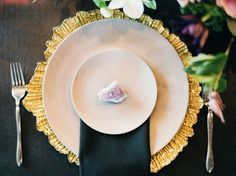 Modern black and amethyst styling, complete with an amethyst crystal stone atop each place setting.