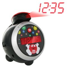 @ShopAndThinkBig.com - The Spectra M&m's Have A Sweet Day Led Projection Clock Radio Is A Fun Radio Clock That Projects The Current Time On Your Wall Or Ceiling. Choose To Wake Up To The Sound Of Your Favorite Am Or Fm Radio Station Or The Alarm Buzzer - Or Sleep In Just A Little Bit Longer With The Clock Radio's Snooze Function. Wake Up To Radio Or An Alarm And The Fun Of M&m's With The Have A Sweet Day Led Projection Clock Radio…
