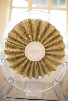 Awesome gold glitter chair decor! // photo by http://www.kristamarielynch.com, via http://theeverylastdetail.com/glittering-pink-and-gold-wedding-inspiration/