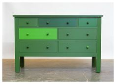 I really like this idea of painting drawers shades within the same family. Especially on such an otherwise classic piece.
