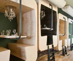 Fabbrica, an upscale pizzeria in Bergen, the Netherlands, manages to be cute without crossing into cutesy by creating dining booths that resemble train dining cars.