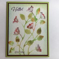 """By Patsy Collins. Second generation stamping. Use corners of Distress ink pads to ink """"Climbing Vine"""" (Woodware). [rusty hinge, mowed lawn, peeled paint, fired brick, dusty concord, gathered twigs] Spritz stamp with water; stamp onto watercolor paper; save for use on another card. Spritz stamp again without re-inking; stamp onto watercolor paper; use for this card. Use blending tool to apply tumbled glass and peeled paint ink on edges. Mat on dark red; attach to light green base."""
