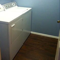 """New Laundry room - Laid """"Golden Select Laminate Flooring (walnut color) over the existing vinyl, then repainted """"overcast sky"""" blue on walls & white molding trim..."""