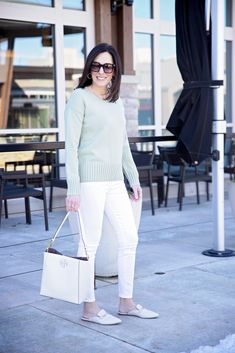 Jo-Lynne Shane shares an early spring outfit for women over 40 in this post. She styles this sweater, in the perfect color for spring, pairing it with white jeans. Accessorizing it with mules and a spring handbag ties everything together. For more fashion tips and examples, check out this post.