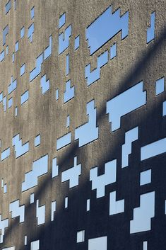 TEA Tenerife - Herzog & de Meuron, Arup, Hufton + Crow.  I like the contrast of the reflective windows with the texture of the concrete!