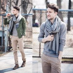 Marcel of One Dapper Street displaying perfect layers. Sweater with a mid weight military inspired jacket with chinos and a huge knit scarf.