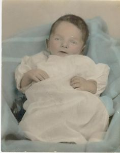 Richard Leon Joy, died at 21 days old. Notice the painted eyes over his eyelids. Precious little angel.