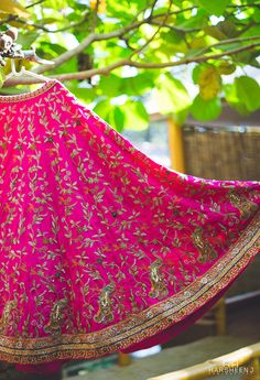 Bright pink silk lehenga with all over embroidery | #lehenga #wedmegood #indianbride