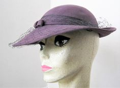 VintagObsessions presents this purple wool hat by Betmar New York. Features a wide brim, black net v