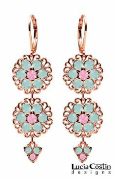 Spotlight-Stealing Flowery Chandelier Earrings by Lucia Costin Crafted in 14K Yellow Gold Plated over.925 Sterling Silver with Mint Blue and Rose Pink Swarovski Crystal Flowers and.925 Sterling Silver Fancy Charms, Decorated with Filigree Ornaments Lucia Costin. $78.00. Update your everyday style with inspiration when wearing this piece of jewelry. Beautifully designed with blue opal and rose pink Swarovski crystals. Unique jewelry handmade in USA. European style with classic...