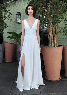 Sarah Seven white sleeveless wedding dress with deep v-neckline and high leg slit Fall 2016 | https://www.theknot.com/content/sarah-seven-wedding-dresses-bridal-fashion-week-fall-2016