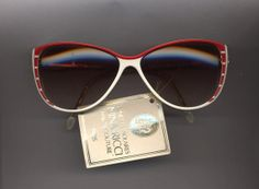 THE SUNGLASSES IS AN ORIGINAL FROM THE 80S.  THE FRAME IS NEW OLD STORE STOCK THAT HAS BEEN IN A.C. STORAGE FOR MANY YEARS,  THIS IS THE LAST ONE WE HAVE AVAILABLE AND I  DOUBT IF WE WILL BE ABLE TO FIND ANY MORE FROM THAT ERA.  THE MAJORITY OF SUNGLASSES I SELL ARE FROM  www.theeyestop.com  WHO ALS...