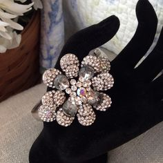 """Blingy Bracelet Silver tone rhinestone flower.  Really cute.  A little tarnished with just 2 stones missing. Bought from a boutique at the sponge docks in Tarpon Springs Florida. Flower is 2"""" all the way around. Jewelry Bracelets"""