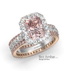 Bez Ambar's Ring of Fire with a fancy pink radiant center and Blaze® diamonds. #diamondjewelry #blazecutdiamonds #ringoffire #engagementrings www.bezambar.com
