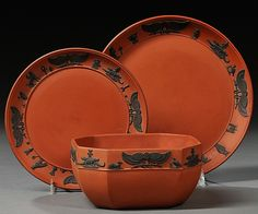 Three Wedgwood Egyptian Rosso Antico Items, England, 19th century, each with applied black hieroglyphs in relief, including an octagonal bowl, lg. 5 3/8; and two plates, dia. 6 3/8, 7 5/8 in.; impressed marks.