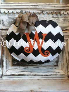 Hey, I found this really awesome Etsy listing at https://www.etsy.com/listing/195737217/chevron-pumpkin-burlap-door-hanger