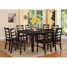 Image from http://img1.wfrcdn.com/lf/50/hash/22976/9179794/1/East-West-Furniture-Fairwinds-9-Piece-Dining-Set-FL9-CAP-W.jpg.