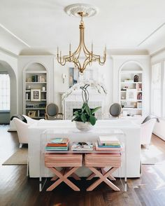 Love the bookshelves and stools under the table. Would prefer wood table