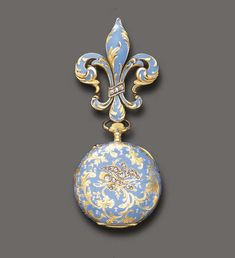 AN ANTIQUE GOLD AND BLUE ENAMEL FOB WATCH, BY LONGINES   With nickel-finished jeweled lever movement, the white circular dial with blue Arabic numerals and gold hands, subsidiary seconds, within an ornately decorated blue enamel case, enhanced by rose-cut diamonds, suspended by a fleur de lys pin of similar design, mounted in 18k gold, circa 1890, with Swiss assay mark  Movement signed Longines; cuvette signed Longines, Grand Prix, Paris 1889; inside case no. 783923