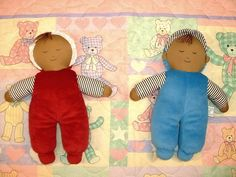 Velour Multicultural Girl & Boy Lovey Doll(Girl has a bonnet and boy wears a cap). These simple cloth dolls are as basic as basic gets.  Safe for newborns and a perfect gift for a new baby.