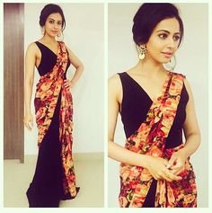 """""""Who doesn't lovee a black Saree that to with floral"""