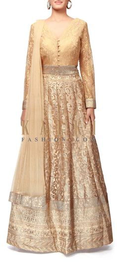 Buy Online from the link below. We ship worldwide (Free Shipping over US$100). http://www.kalkifashion.com/gold-anarkali-suit-enhanced-in-zari-and-kundan-embroidery-only-on-kalki.html